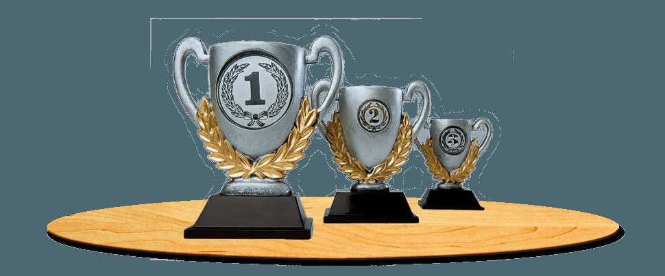 Presentation cups on wooden podium