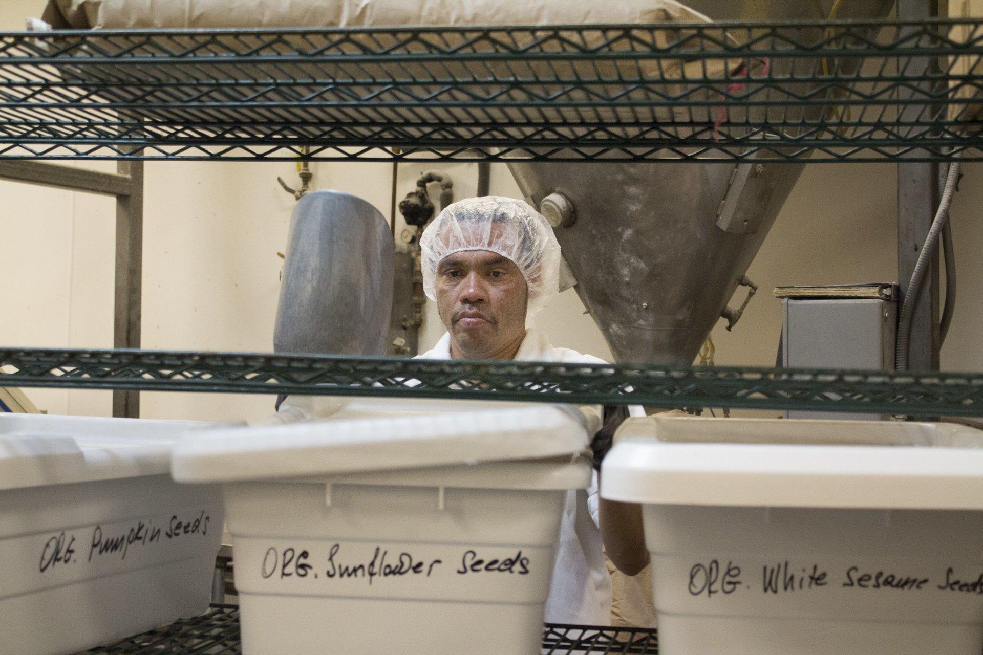Oasis Breads Baker preparing flour