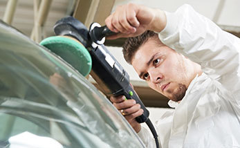 Mechanic polishing auto glass in Waynesboro