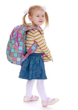 hopskotch kindergarten little girl in pig tails with knapsack