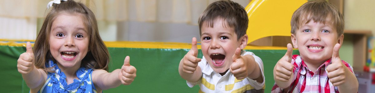 Kids giving thumbs up at a childcare centre in Toongabbie