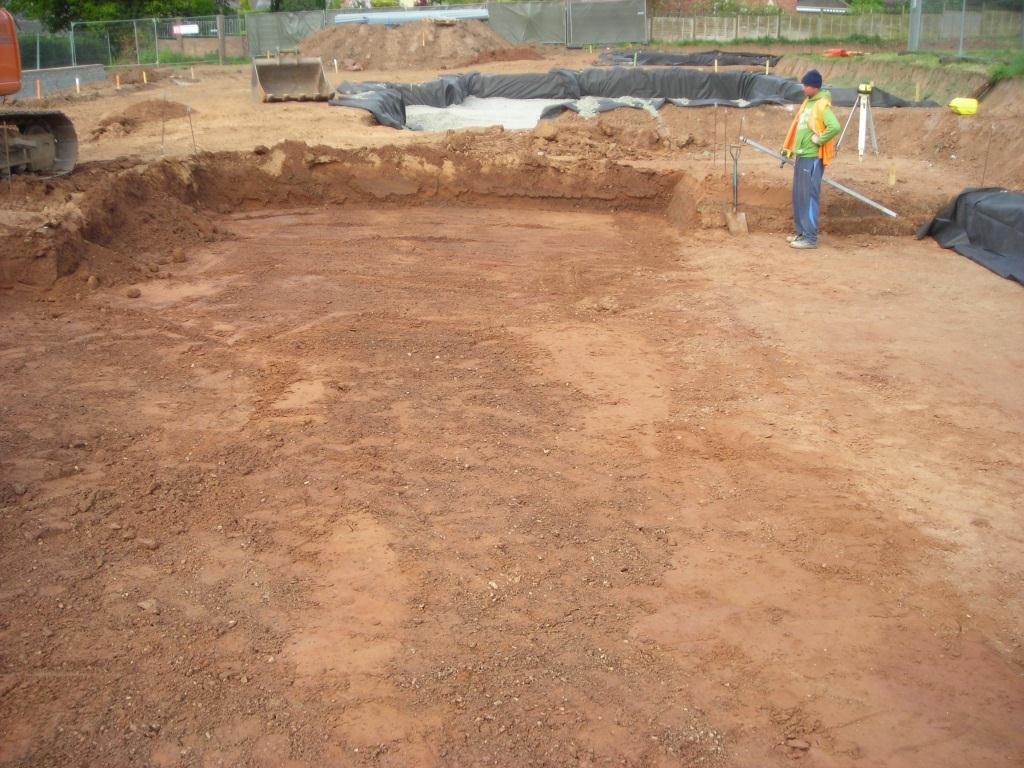 The site is marked out and soil stripped to the formation level.  The actual depth will depend on the local site conditions.