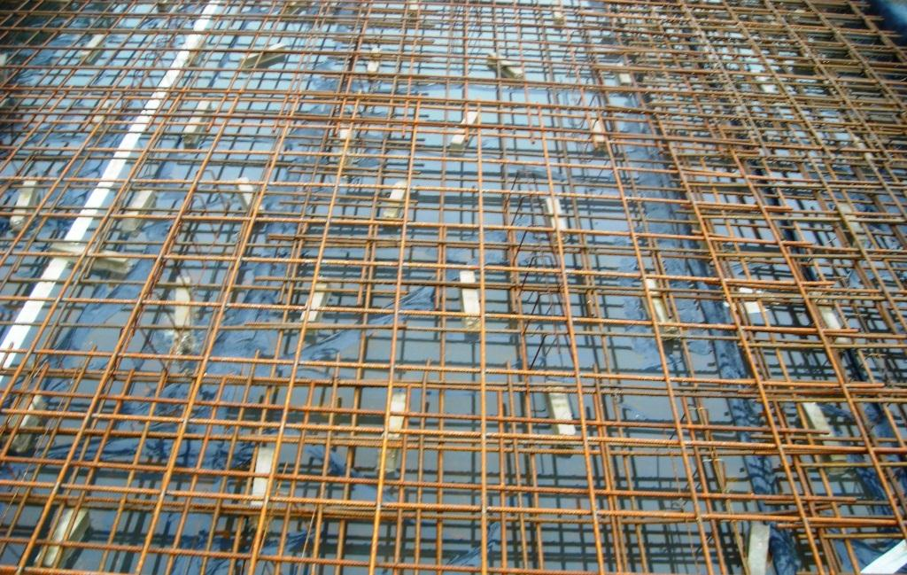 The reinforcement, typically, fabric sheets, is laid on concrete spacers , tied and checked prior to the pour.