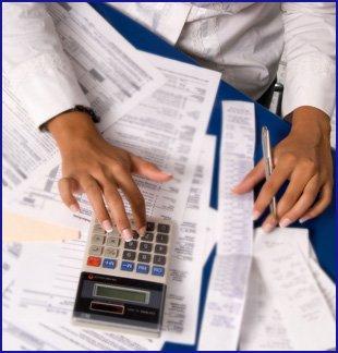 Bookkeeper working on tax returns.
