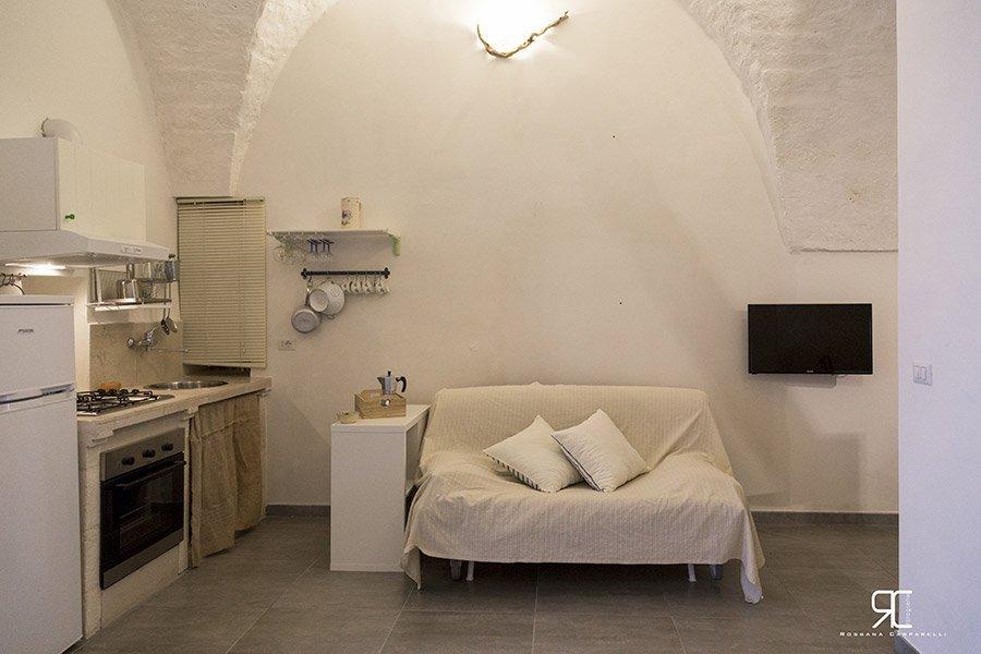 Letto nella camera dell'alloggio Bed & Breakfast 28 a Ostuni