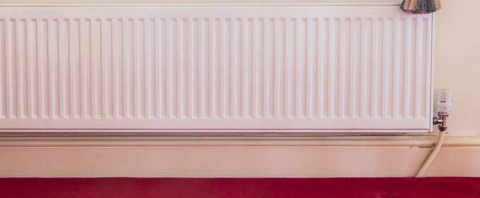 A radiator in need of heating maintenance and power flushing.