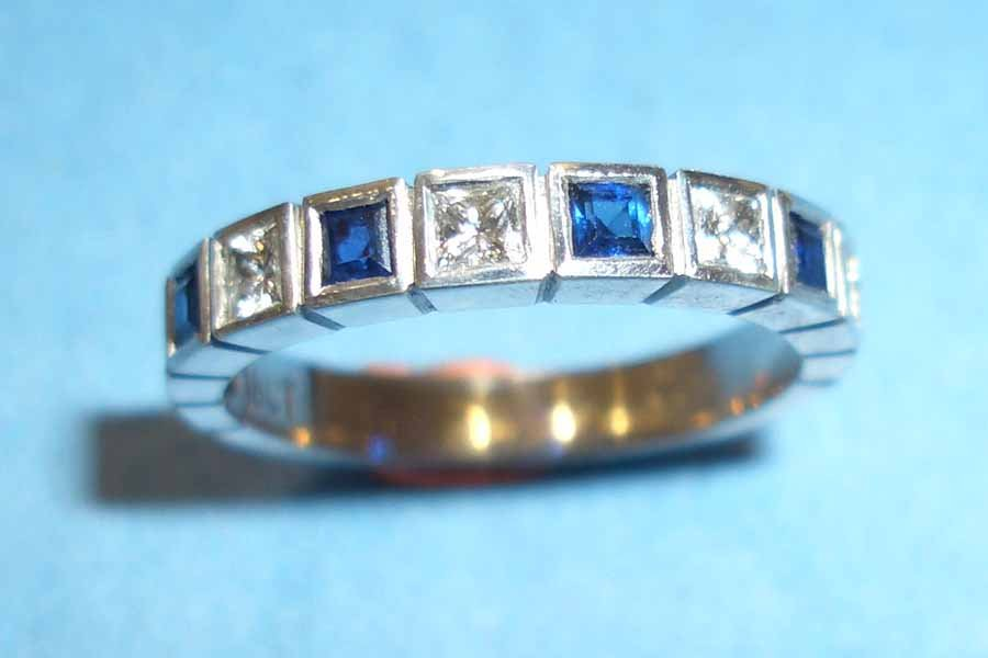 ring with alternating diamonds and sapphires