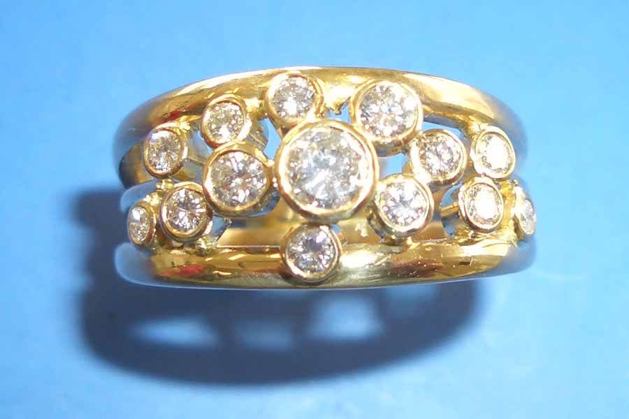 gold ring with multiple circle-cut diamonds
