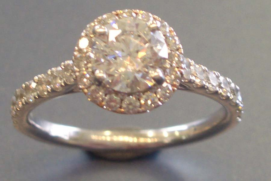 circular stone with ring of diamonds ring