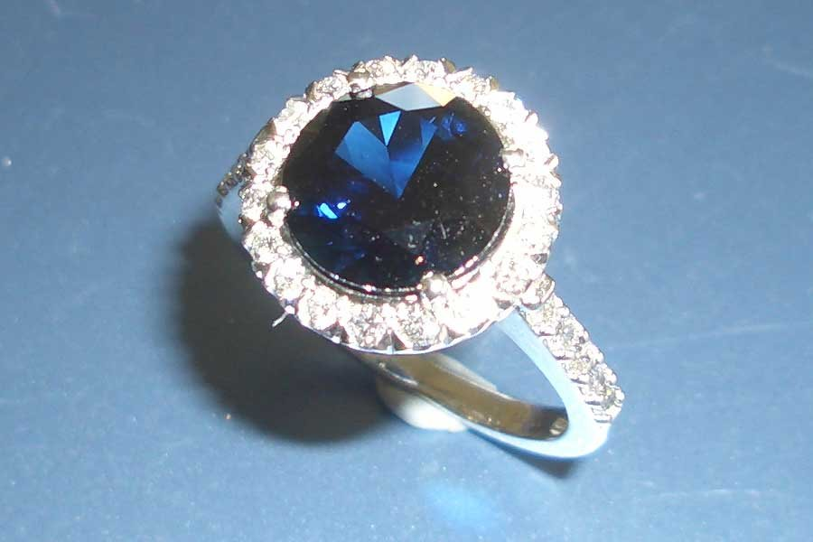 circular sapphire ring with diamond band