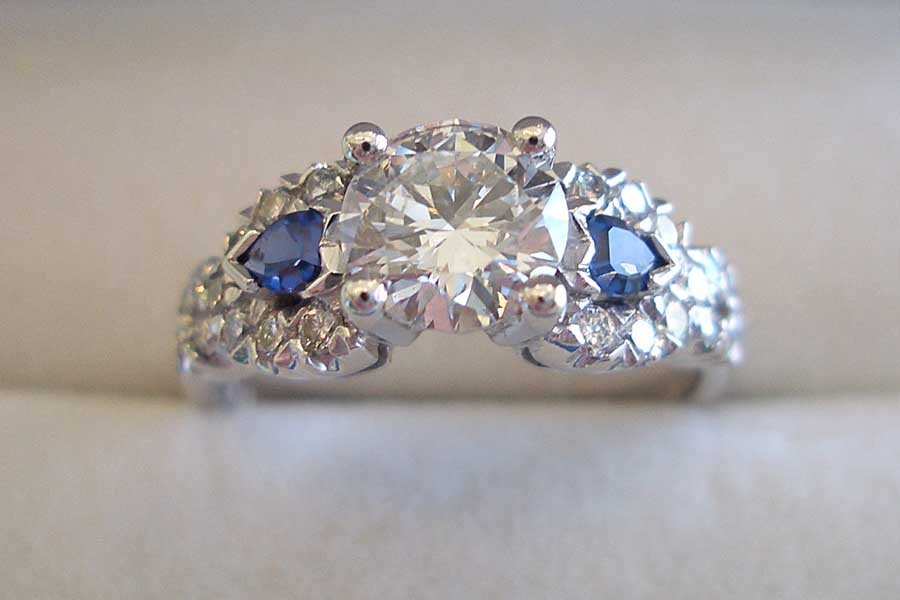 diamond engagement ring with two sapphires