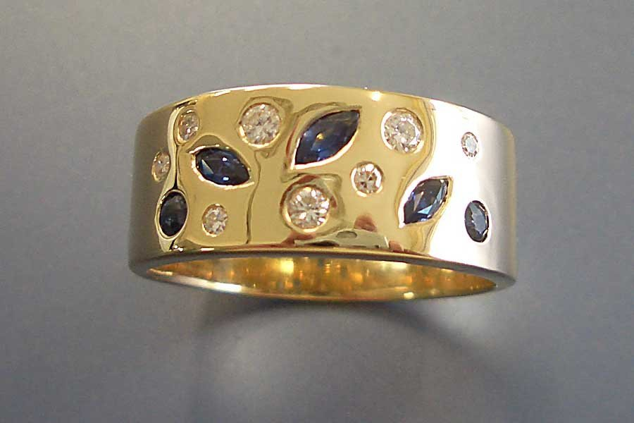 gold ring with inset stones