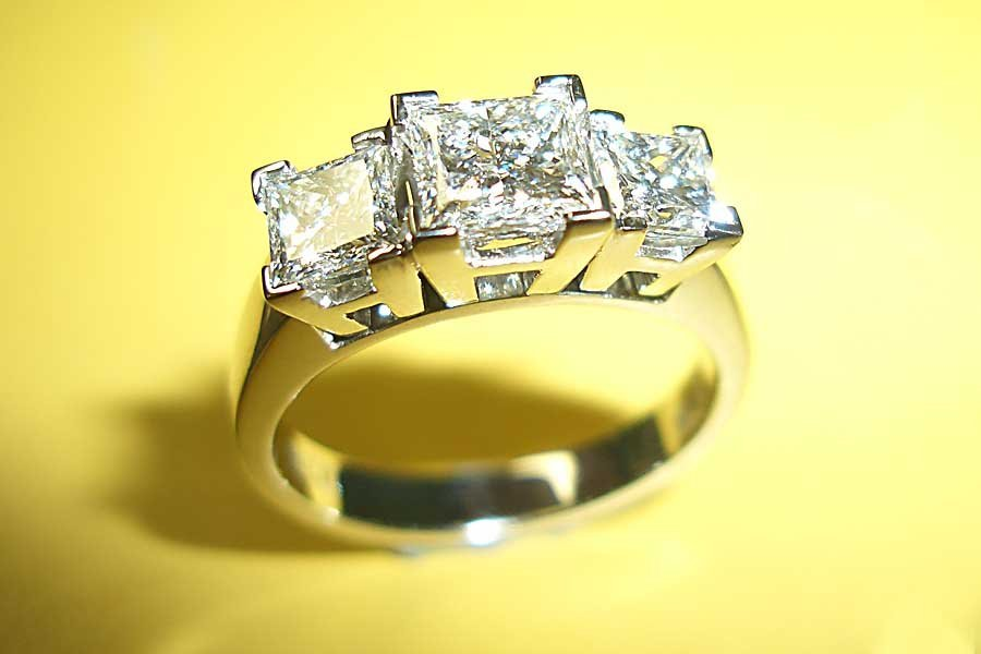 ring with trio of square-cut diamonds