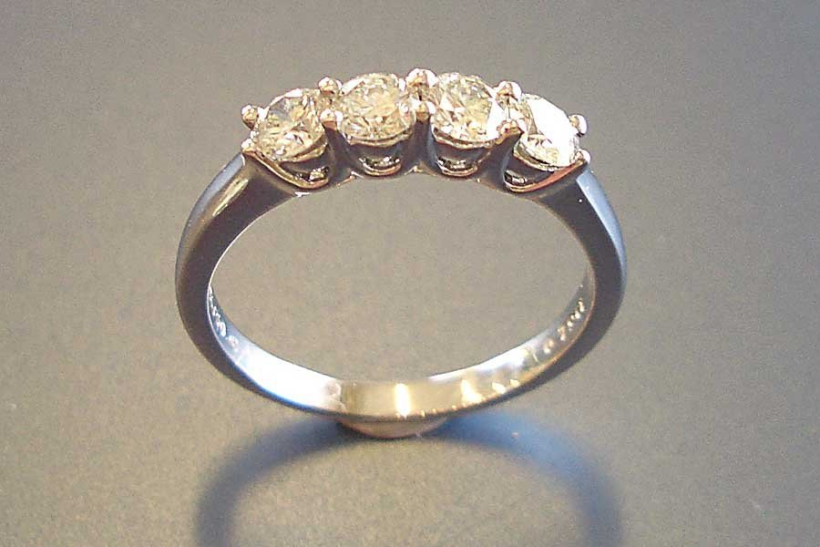 ring with four circle-cut diamonds