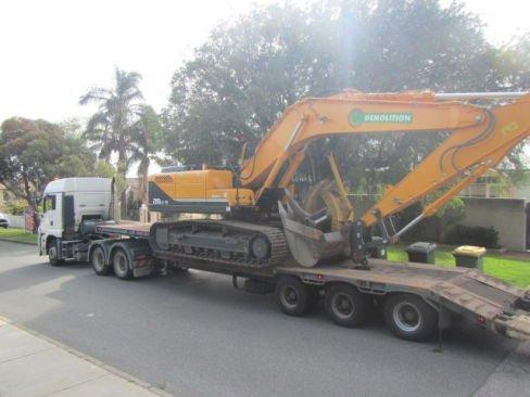 jag demolition truck with excavator
