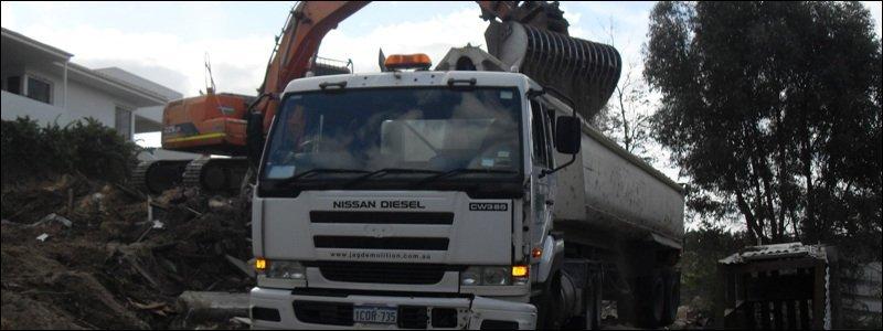 jag demolition excavator on demolition site