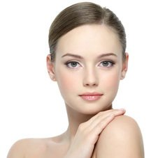 Beautiful lady after liposuction treatment in facial area