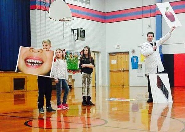 Dentist Dr. Moody at Woodland Elementary School in Edwardsville assembly
