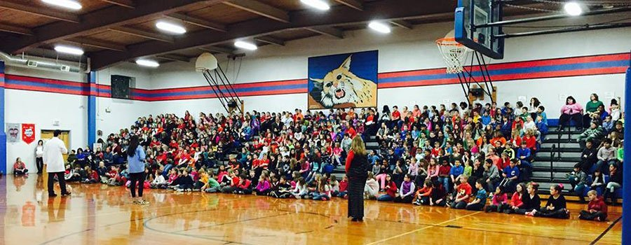 Dentist Dr. Moody at Woodland Elementary School in Edwardsville school assembly
