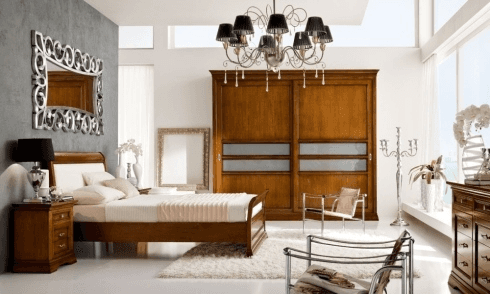 camera in noce scorrevole,camera in legno scorrevole, camera classica con letto imbottito