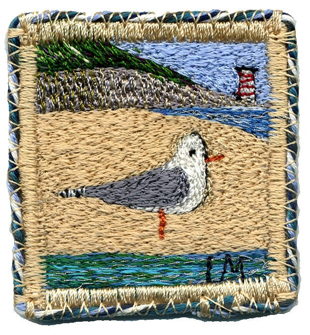 Gull on a Beach. Machine embroidery by Linda Miller