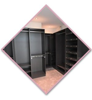 walk in wardrobe with black shelves