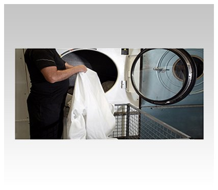 new look drycleaners and laundry service taking clothes from the washing machine