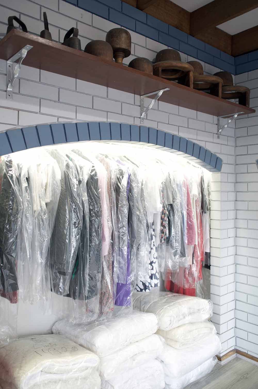 new look drycleaners laundry and linen service cloths kept in plastic covers