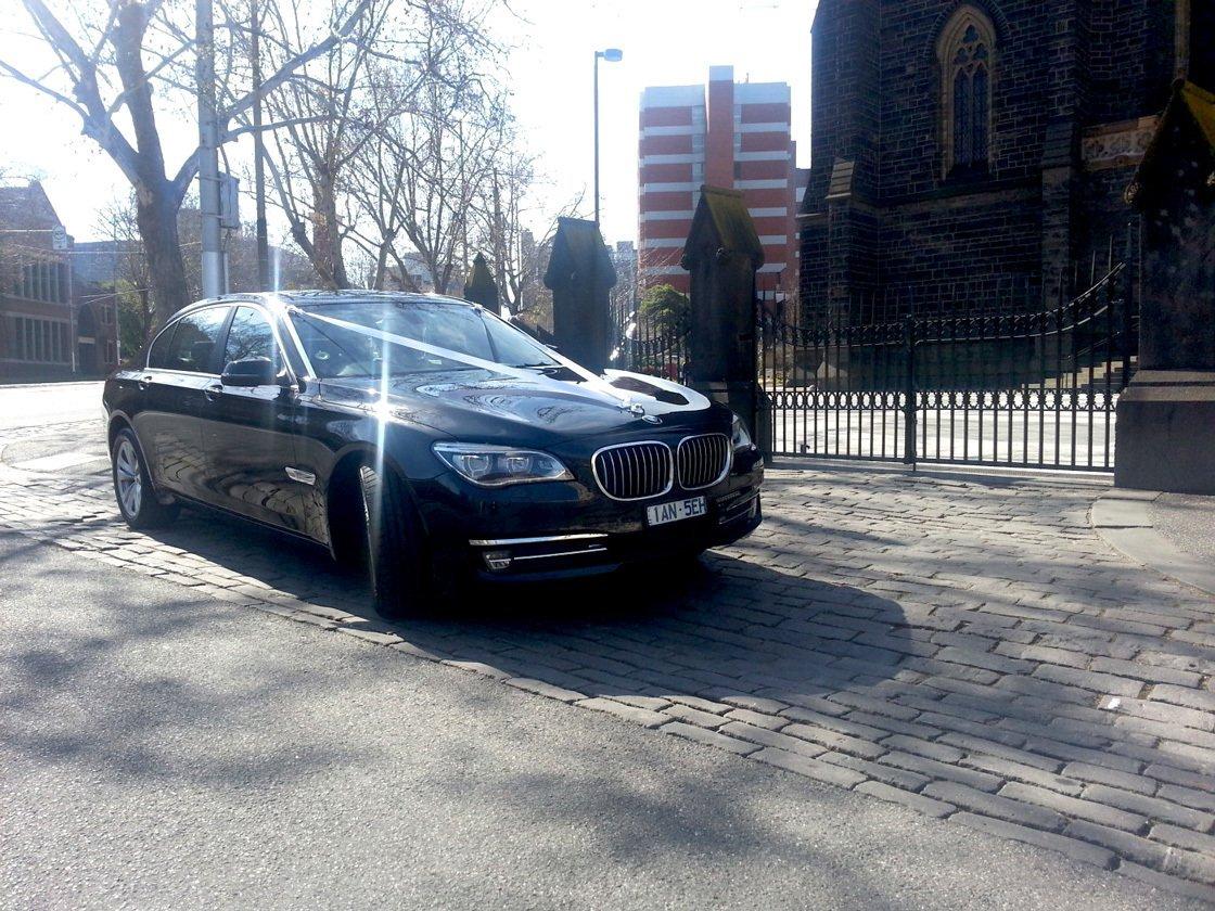 Shining BMW 7 chauffeur car under the Melbourne Sun
