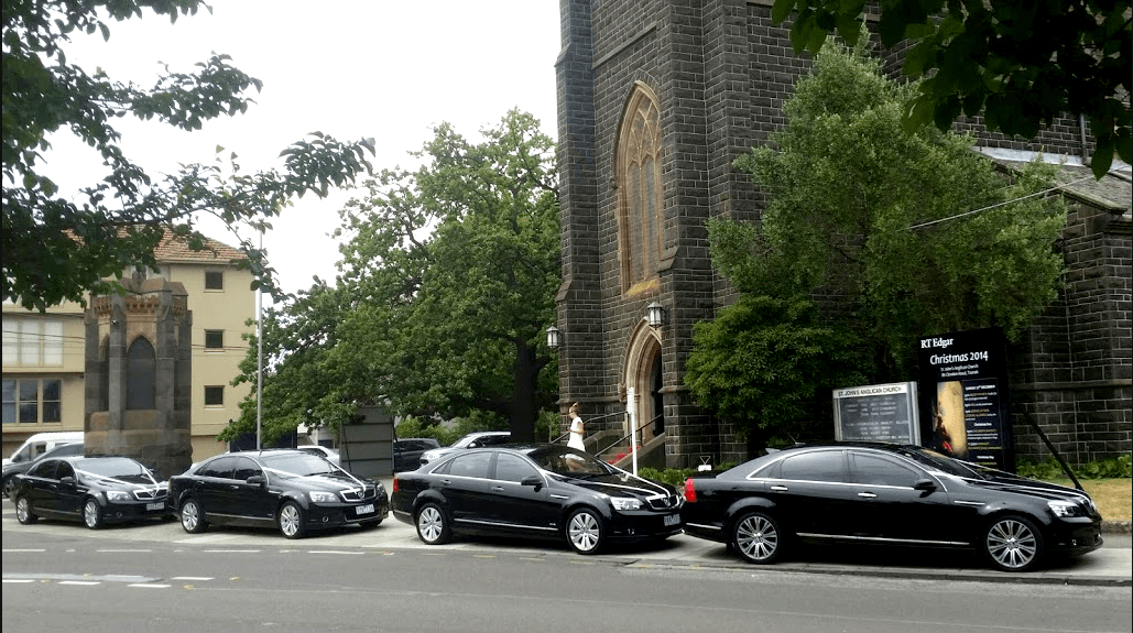chauffeured Melbourne wedding cars in front of a church