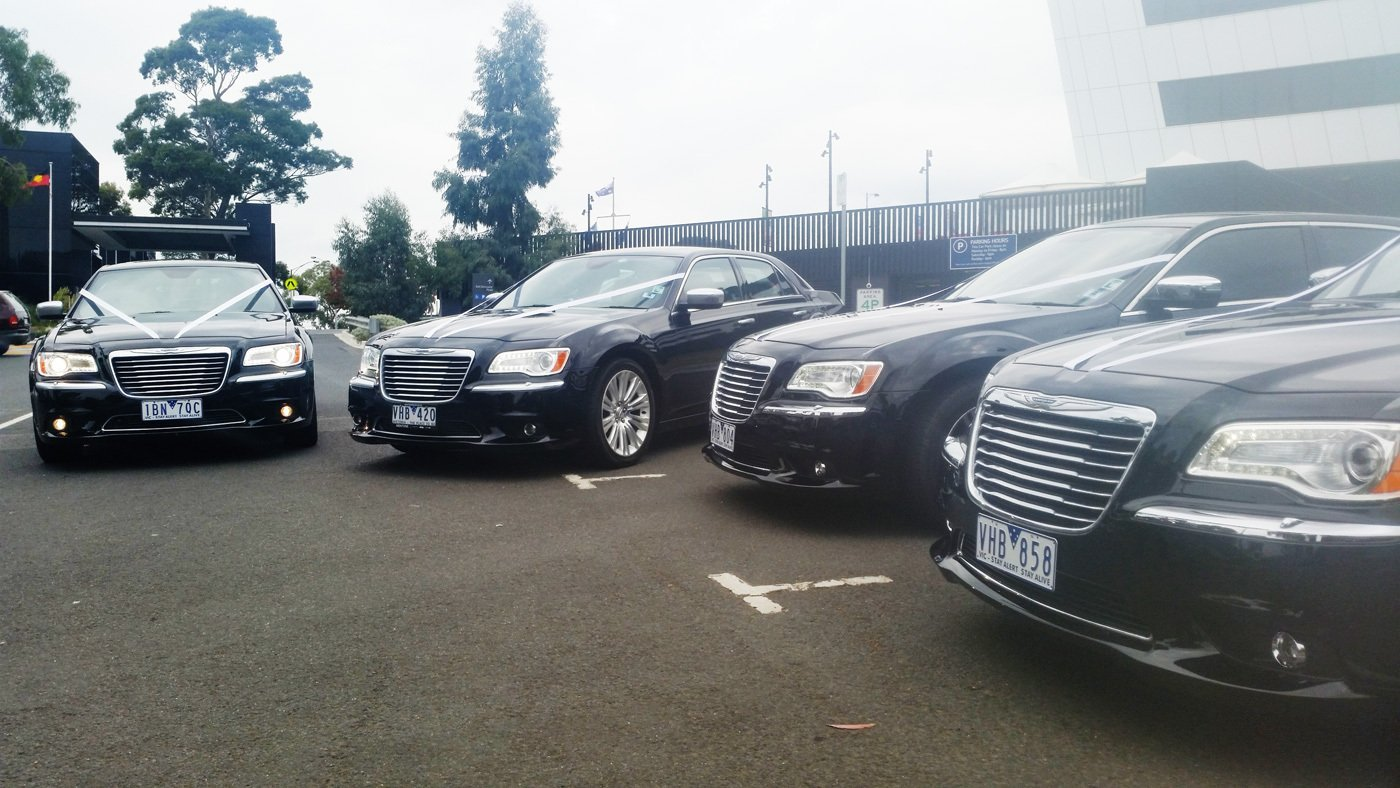 fleet of chauffeured cars in a melbourne wedding