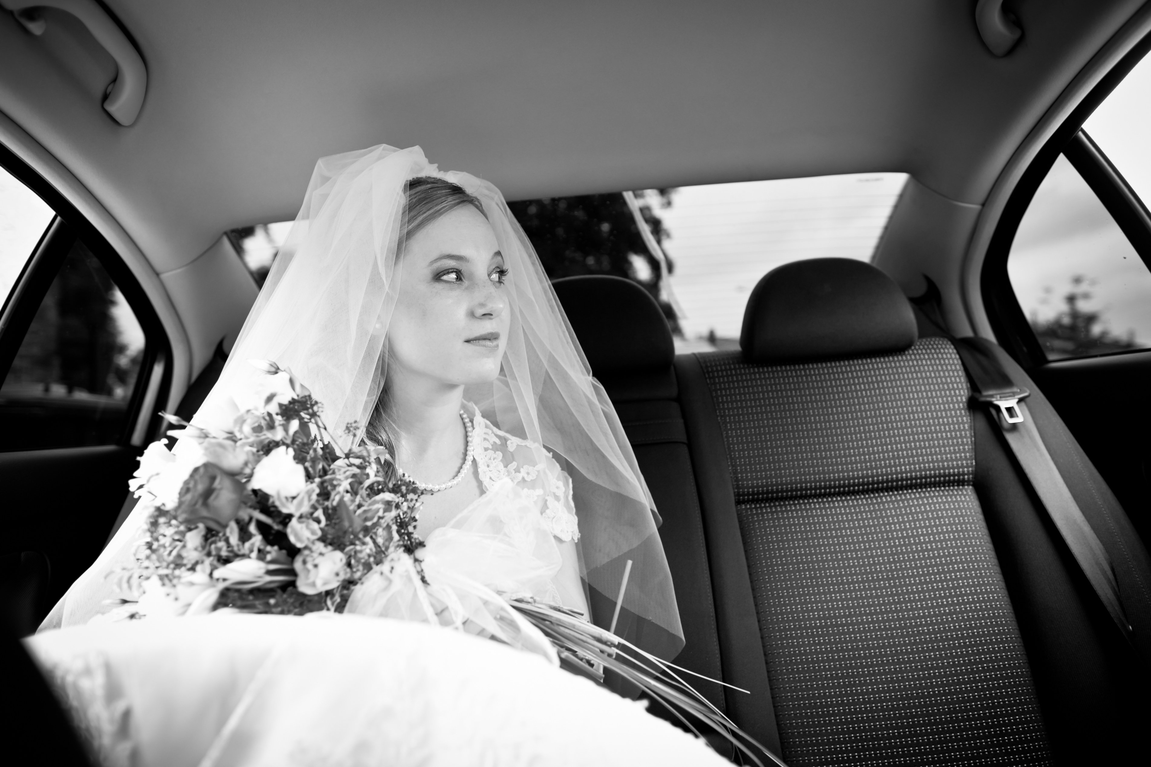 beautiful young bride inside Wedding car hire