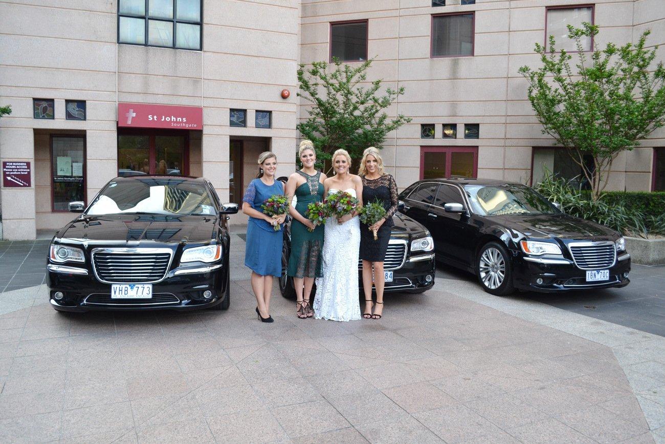 Bride and bridesmaid near Melbourne wedding chauffeur car
