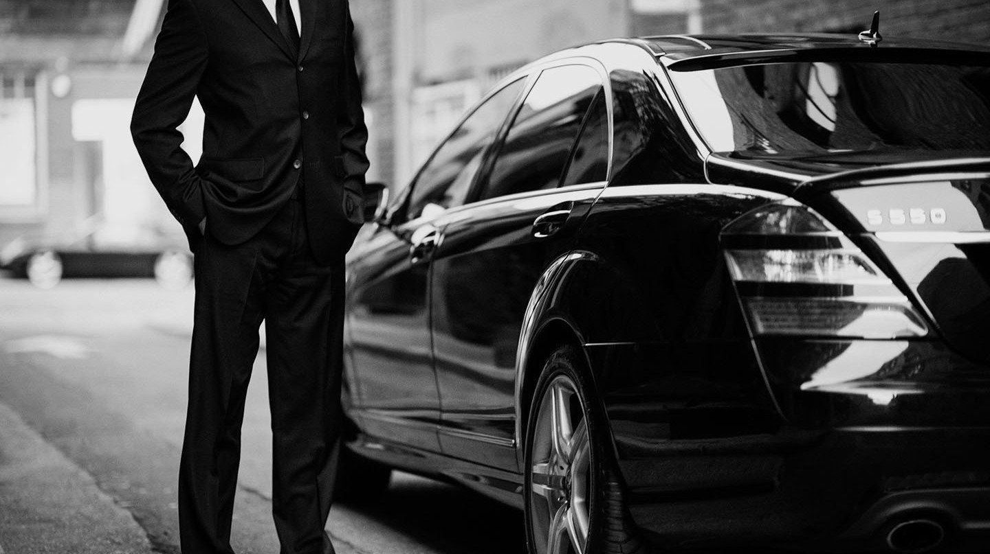 chauffeur melbourne waiting before a Chauffuered black sedan
