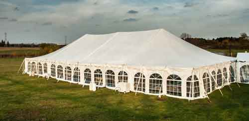 White banquet wedding tent or party tent at twilight time