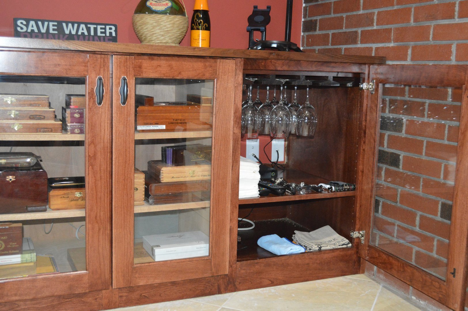 View of white wine refrigerator, humidor and glass cabinet