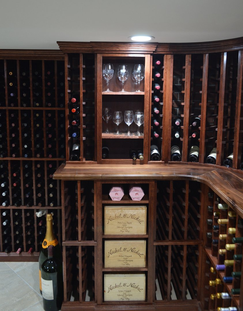 View of stemware cabinet with double deep wood case below
