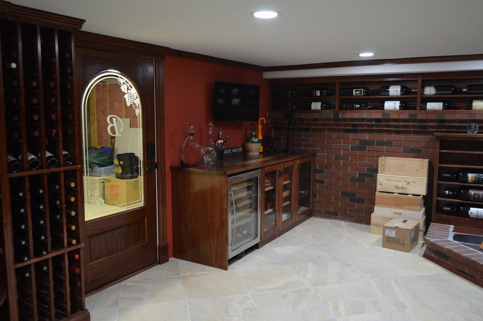 View of white wine refrigerator, humidor, glass cabinet and