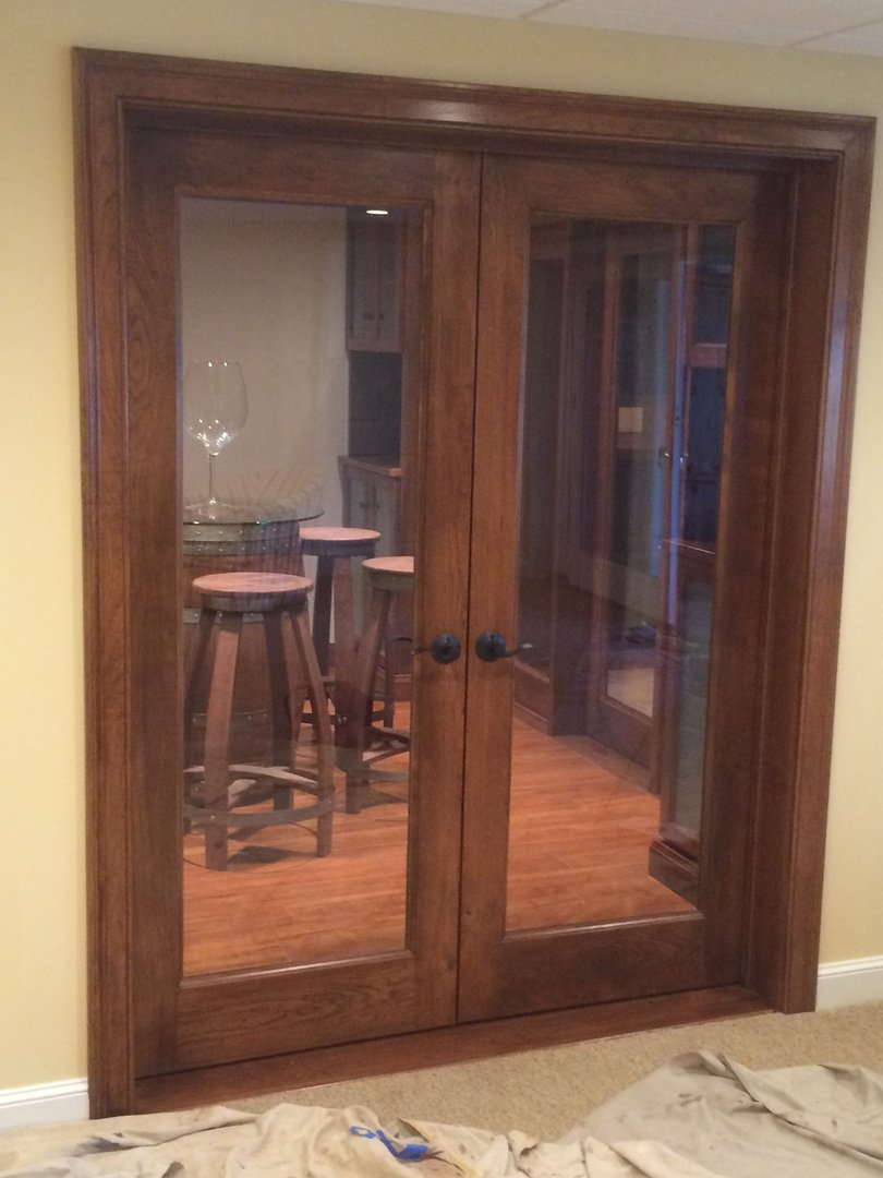 View through cherry doors from the living room into the Tasting Room