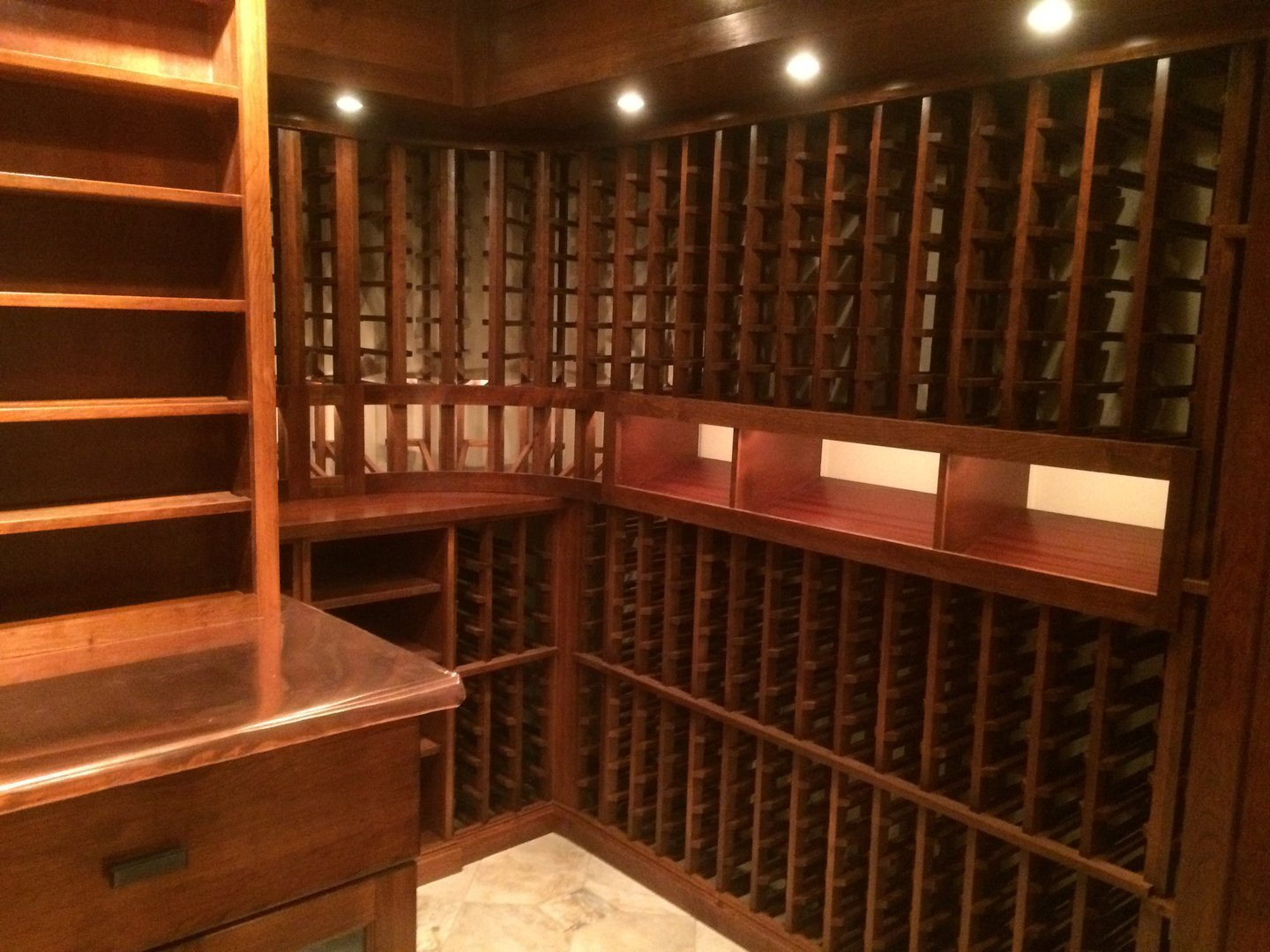 View of copper top, display row and individual wine racks