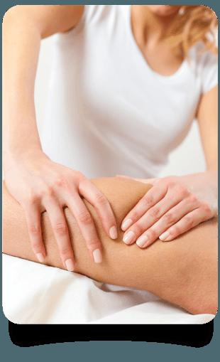 Female therapist massaging a knee