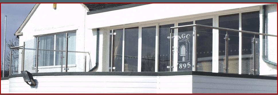 Metal railings and glass balustrades outside a club
