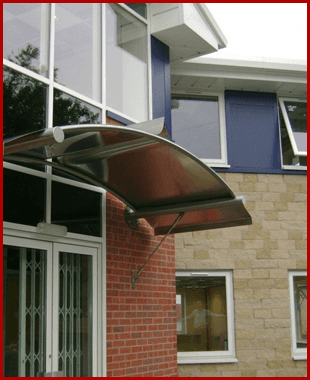 Stainless steel canopy over a door