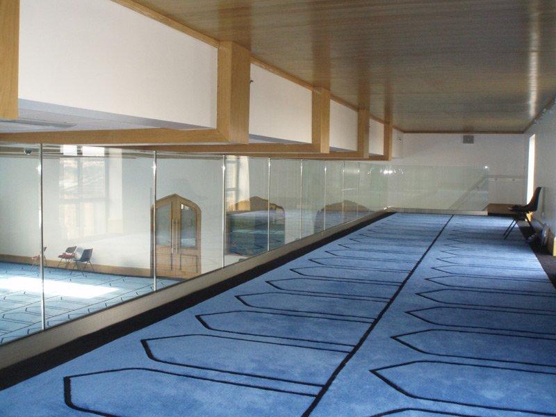 Glass balustrades on a mezzanine floor