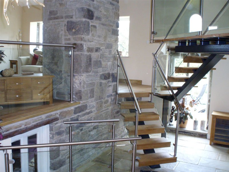 Wooden stairs with a glass balustrade