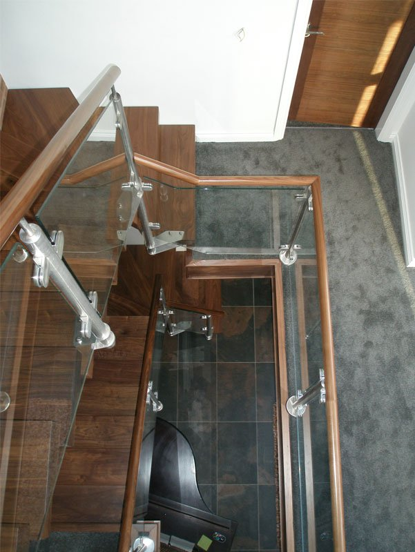 Glass staircase in a reception area