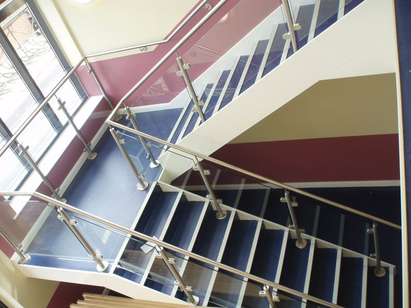 Metal handrails and glass balustrades on a staircase