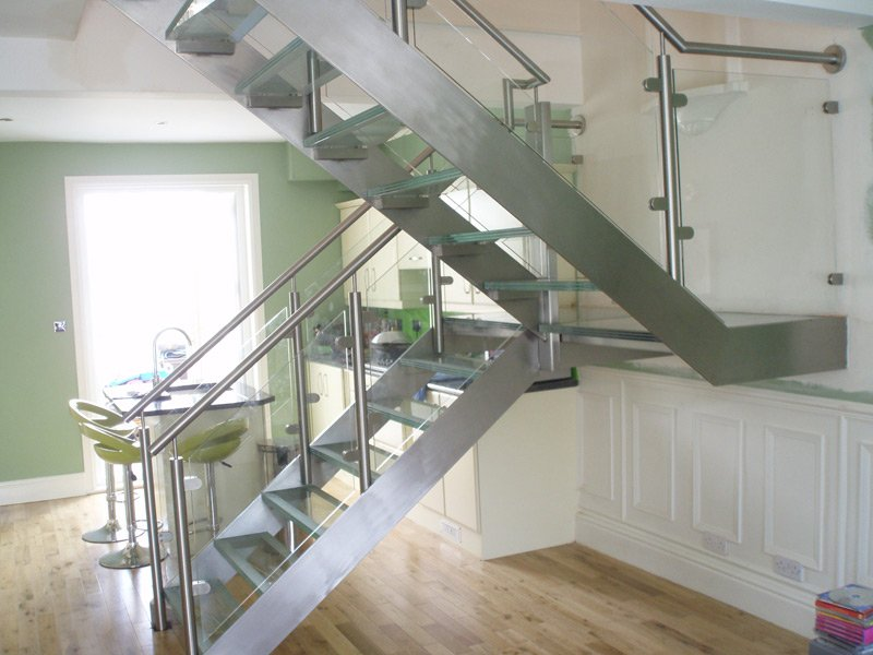 Metal staircase leading up from a kitchen