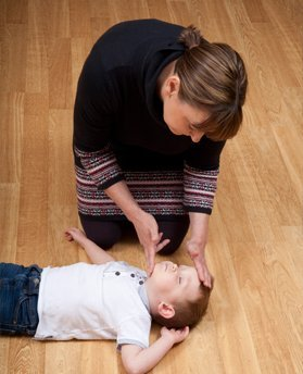 Practising CPR on a child manikin