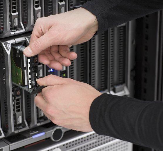 An IT technician replacing an element of a server